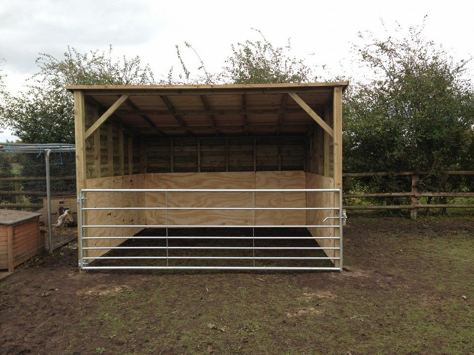 Outdoor shelter fitted with metal field gate. (CG Services)