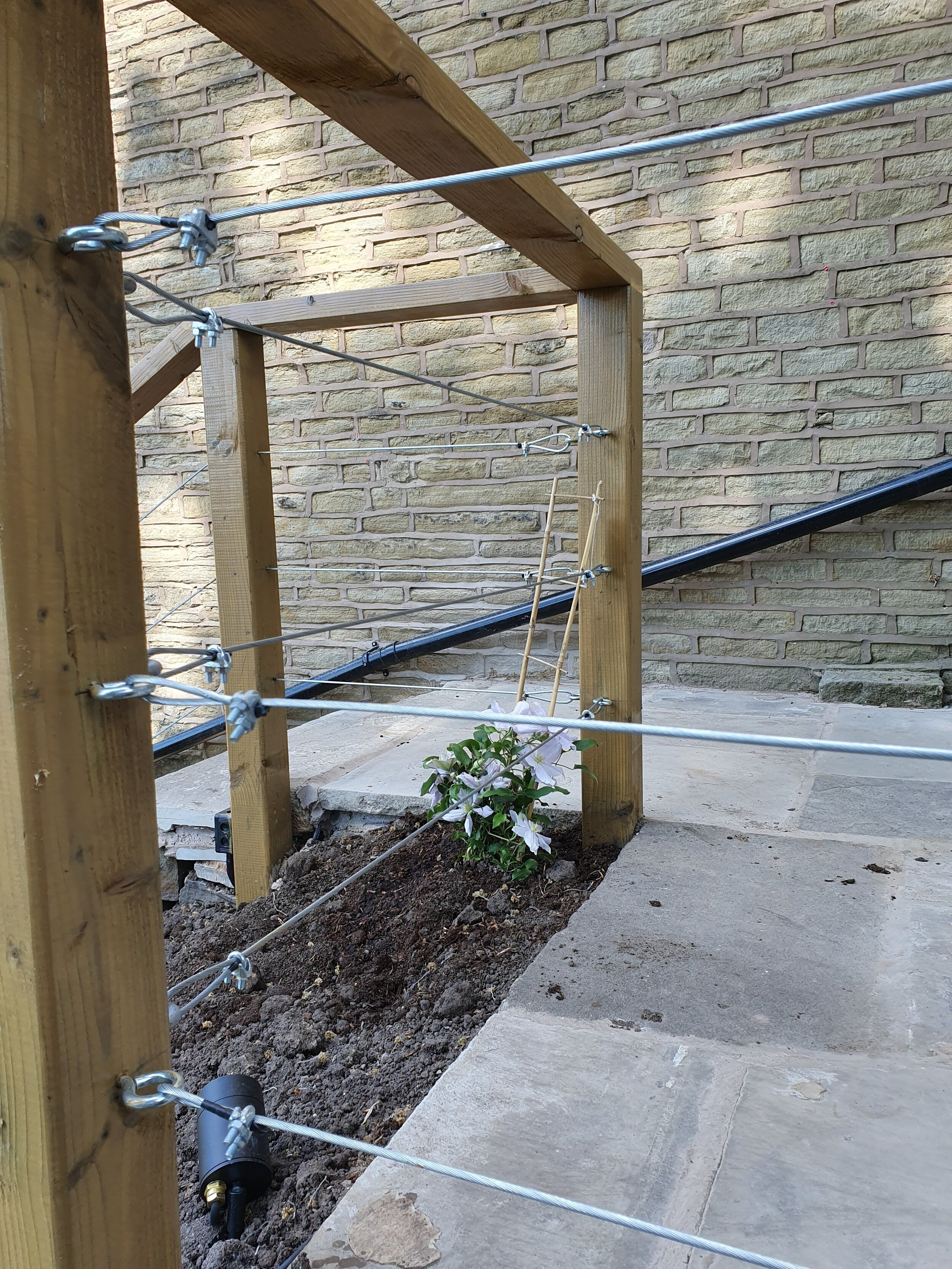 Steve Bailey used our 4mm wire rope, welded eyebolts and rope grips to create this modern barrier.