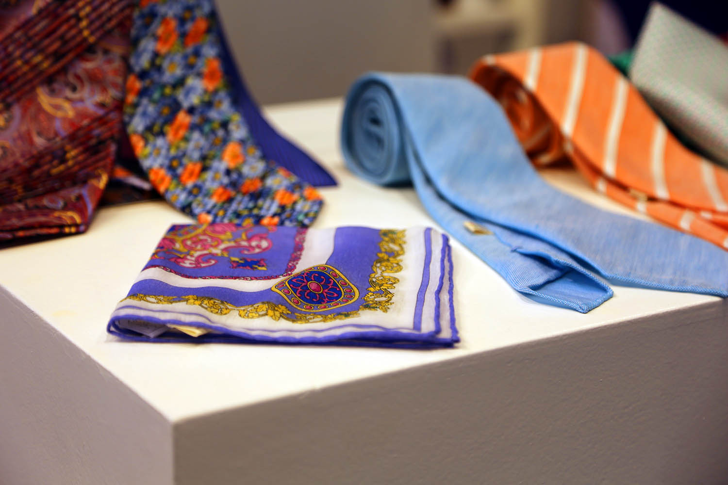 Ties and pocket square on display table.