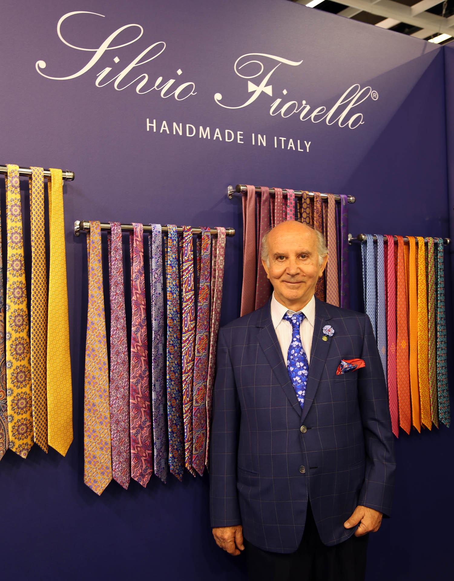 Silvio Fiorello in person with tie exhibition display.