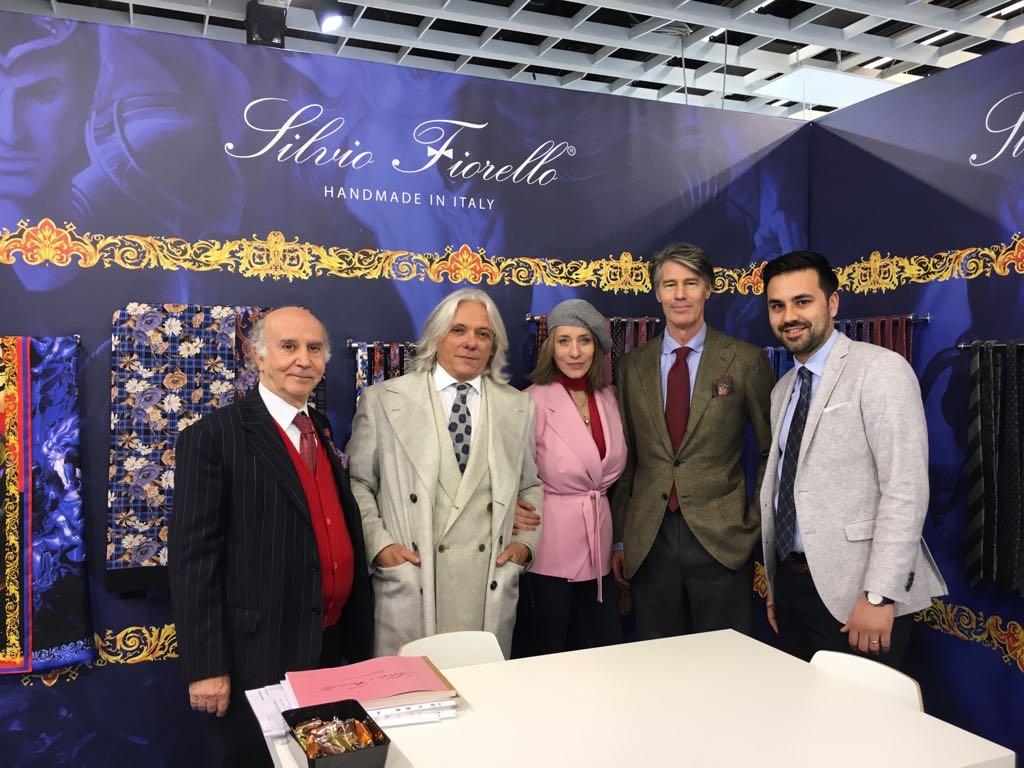 Team and guests at Pitti Uomo exhibition.