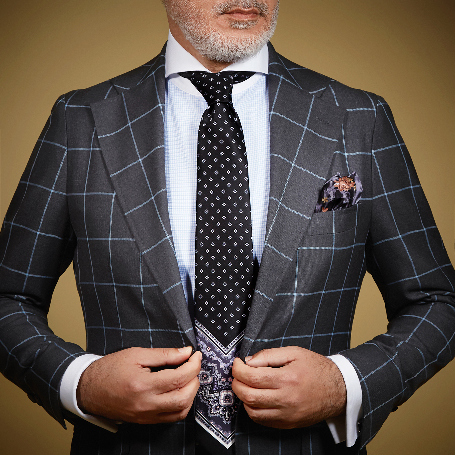 Person dressed in suit with tie and pocket square
