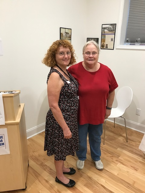 Diana Roof, Temple Sinai Jewish History Center Site Manager (left), with Sue Scouten — one of the first customers to the gift shop