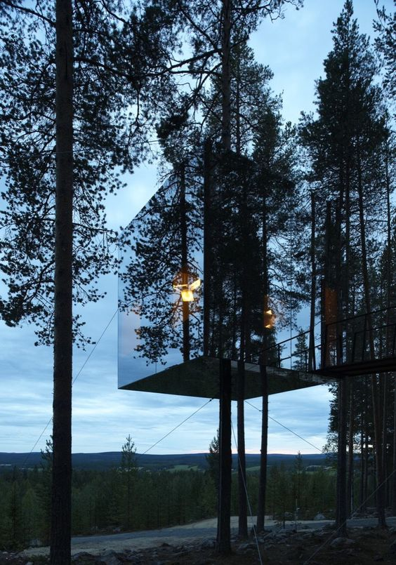 A tree hotel in the far north of Sweden, near the small village of Harads, close to the Arctic Circle. Mirror cube created by architectural firm Tham & Videgård Arkitekter. www.byrastrom.com
