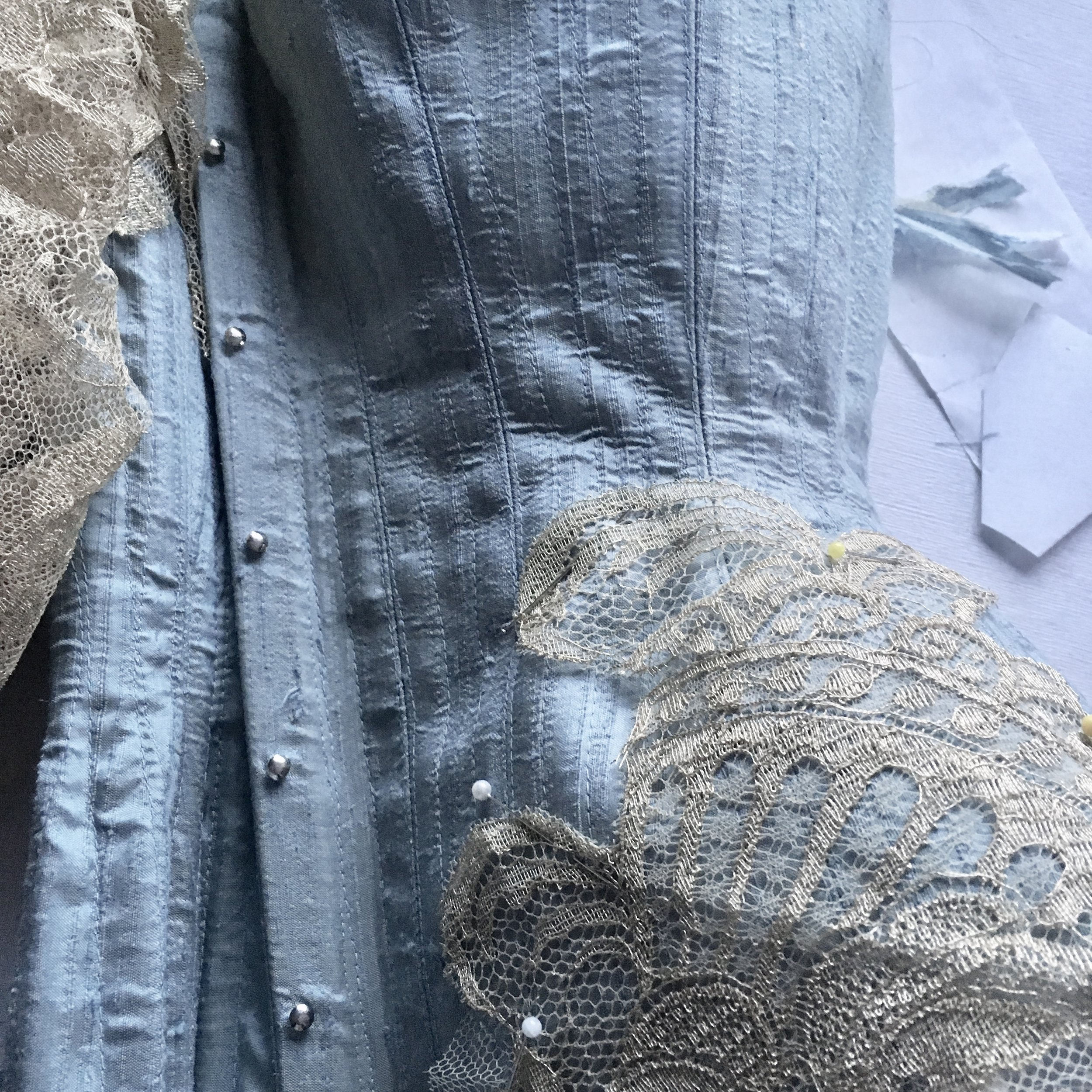 As you can see, on the bonded side of the corset, there are plenty of unsightly bubbles and wrinkles, which I am still frustrated by. Further research and experimentation will be needed on methods of fusing fabrics.