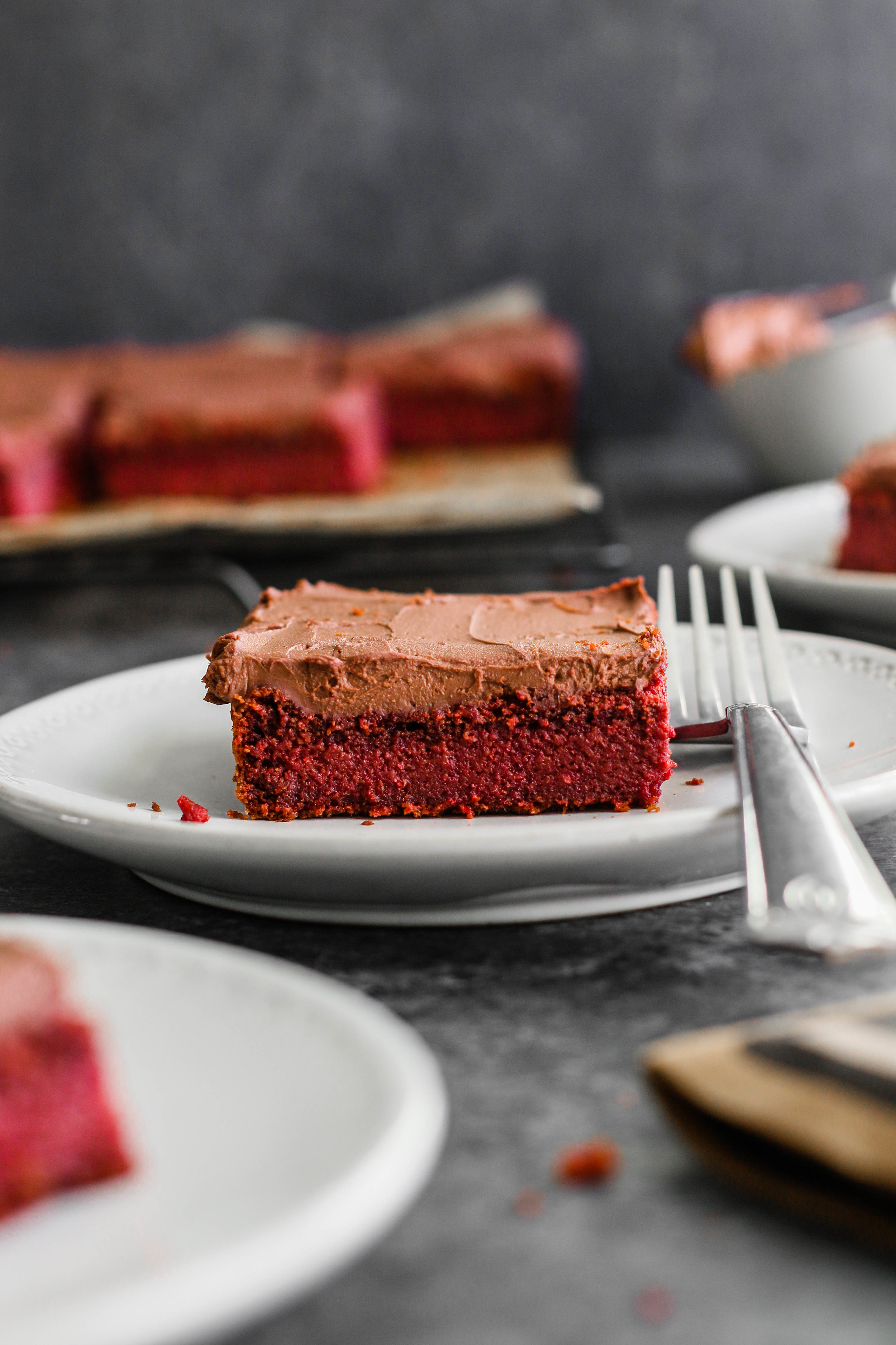 Vegan and gluten-free  red velvet cake  sweetened with unrefined coconut sugar and made red with raw beets. Finish it off with a decadent 2-ingredient chocolate frosting. A blend of oat and almond flour create a fluffy gluten-free flour batter that's sweetened with unrefined coconut sugar.