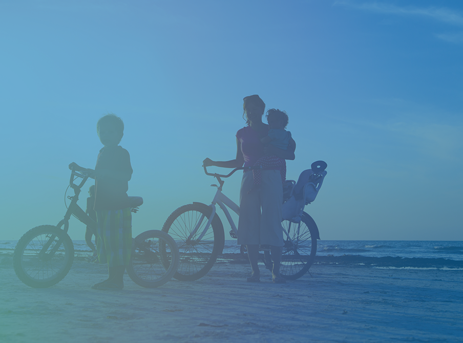 Mother-Riding-Bikes-On-The-Beach-With-Her-Son-And-Baby-variable-life.png