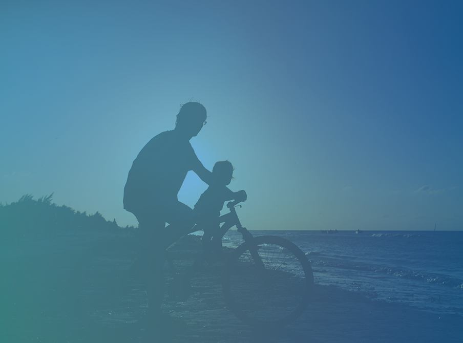Father-Taking-His-Son-For-A-Bike-Ride-On-The-Beach-uni-life.png