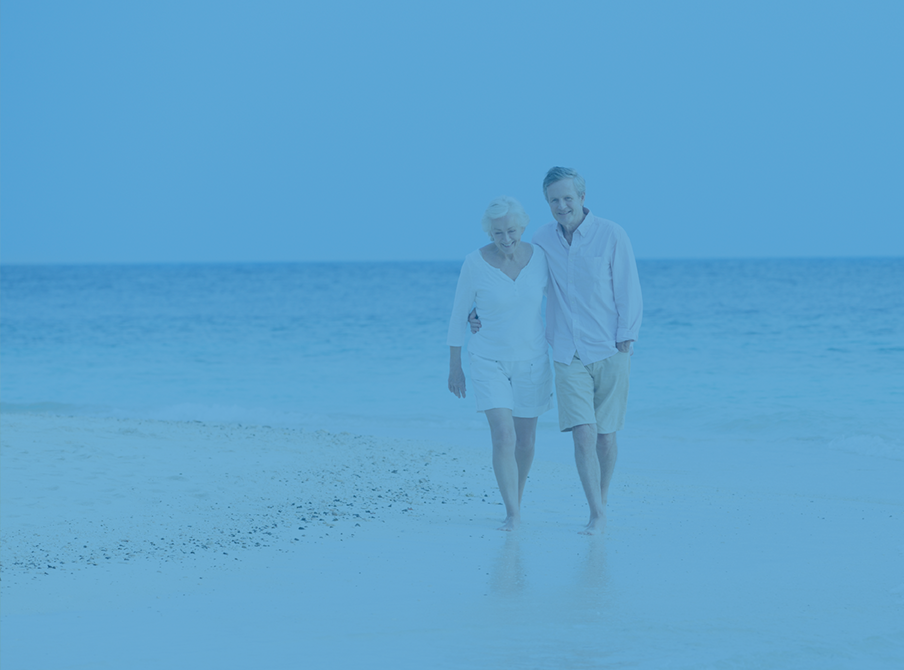 Older-Couple-Taking-A-Walk-Along-The-Beach-whole-life.png
