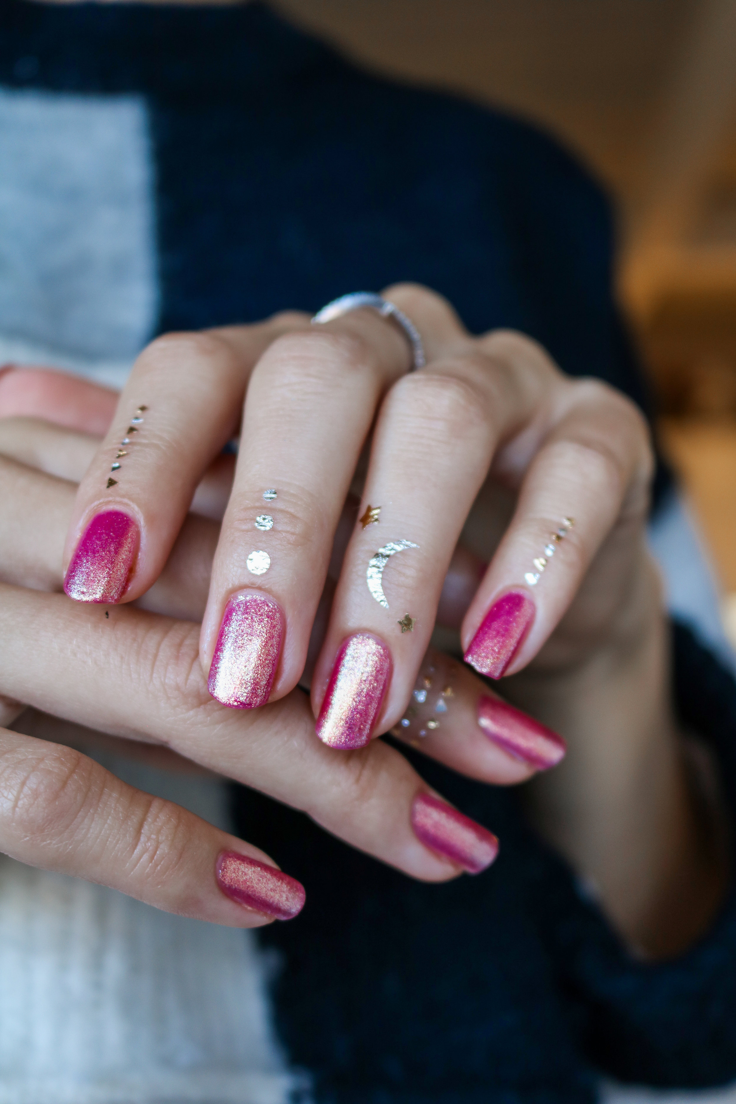 The Hungarian Brunette Urban Outfitter nail polish in Damsel - sparkly pink with gold undertones