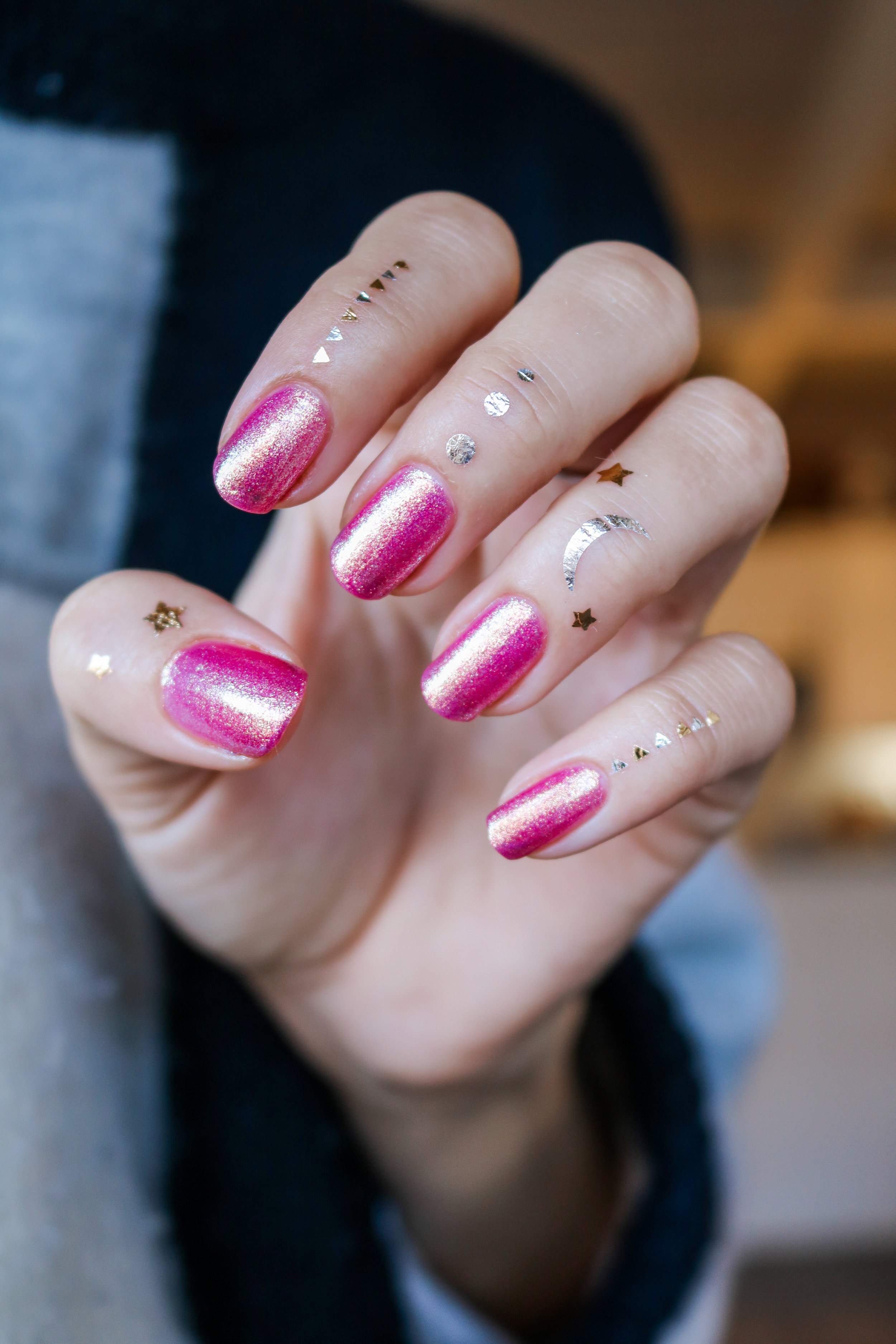 The Hungarian Brunette Urban Outfitter nail polish in Damsel - sparkly pink with gold undertones (5 of 6).jpg