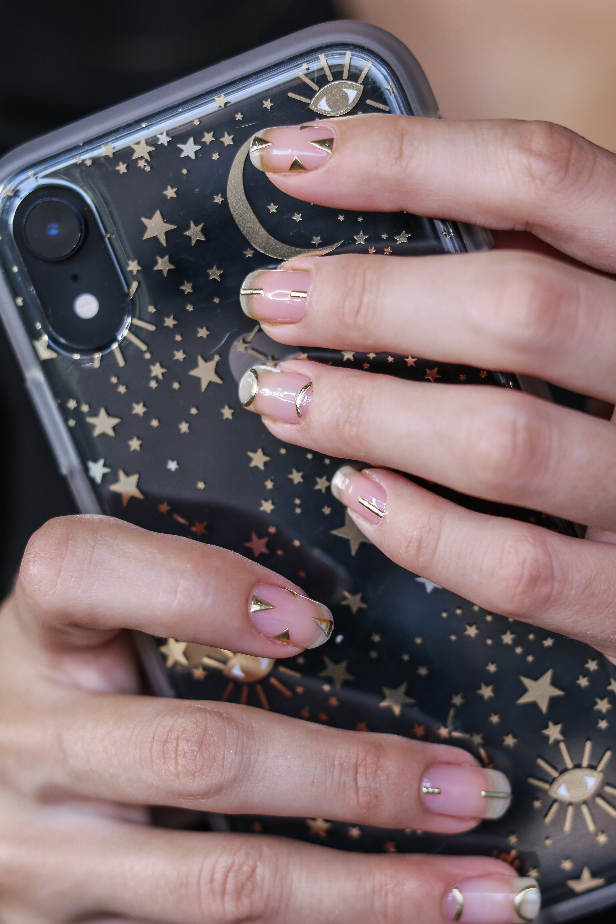 The Hungarian Brunette Minimal Negative space manicure with gold geometrical accents