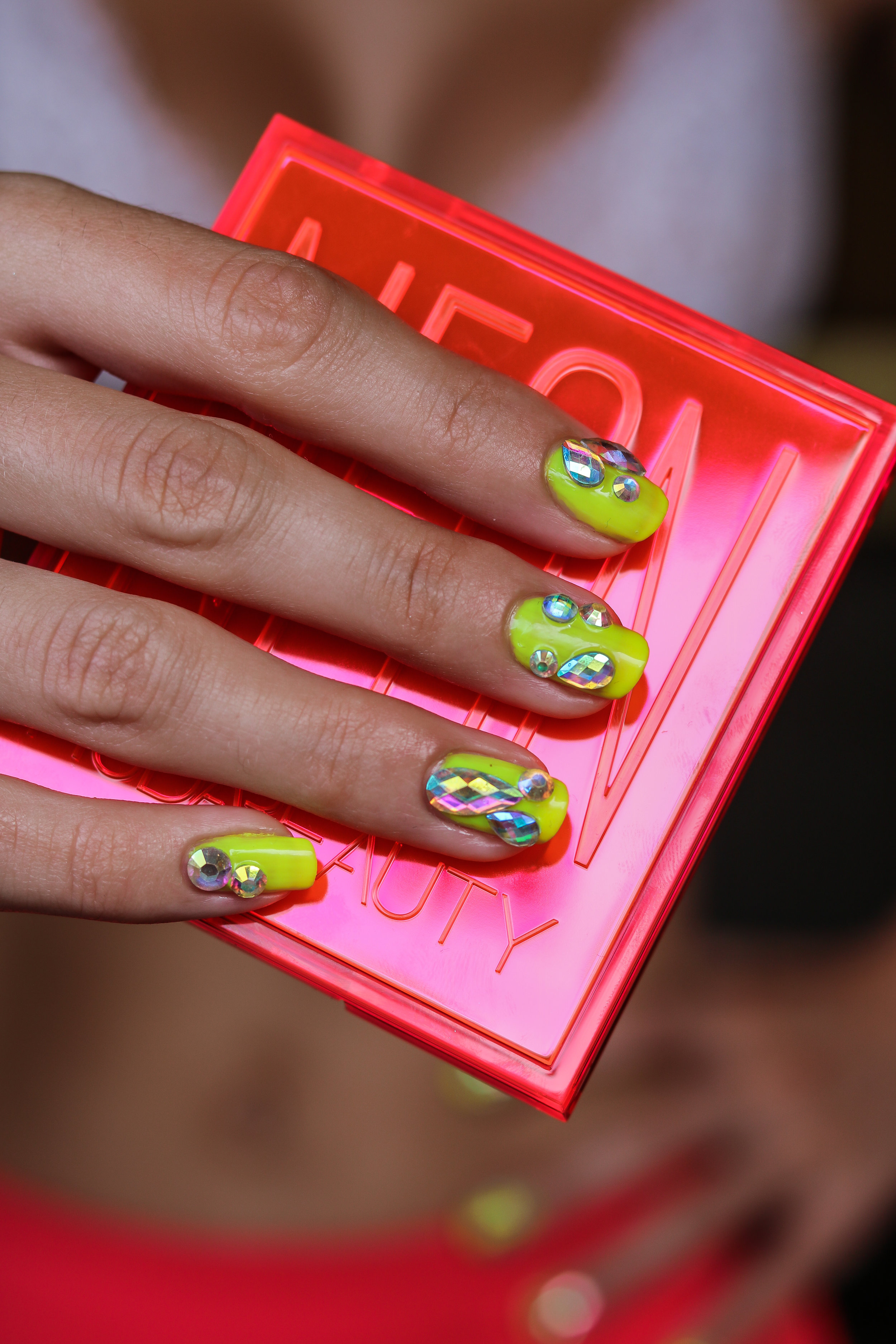The Hungarian Brunette Bright Summer neon yellow nail art with holographic crystals