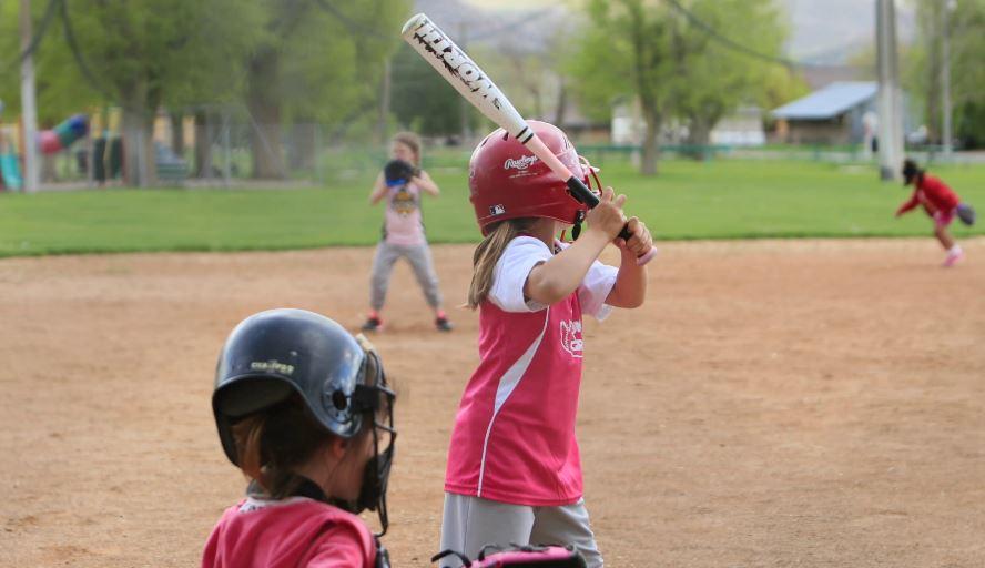 Girl Hitting Softball.JPG