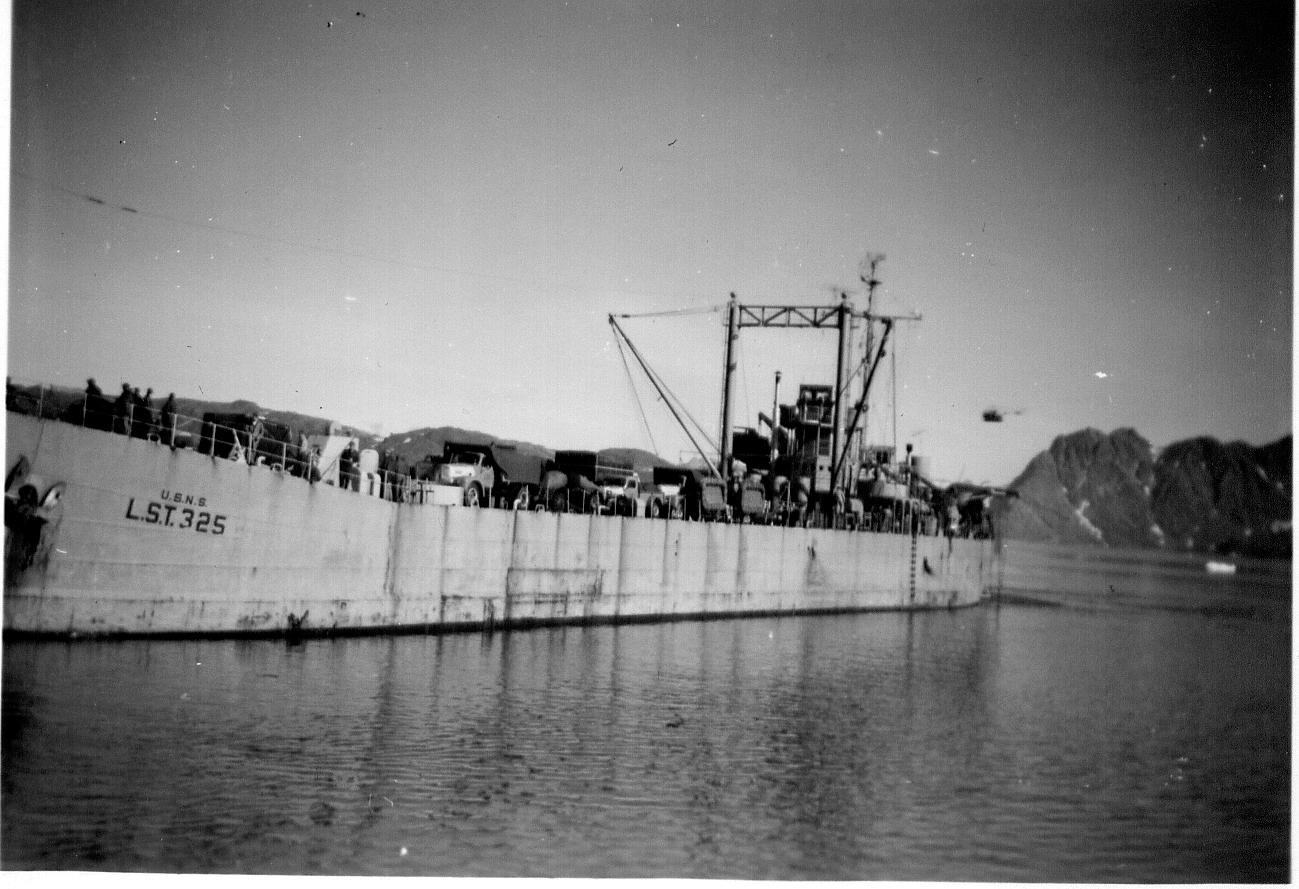 In MSTS, designated USNS LST-325, docked for unloading Kulusuk, East Greenland, 1960-61