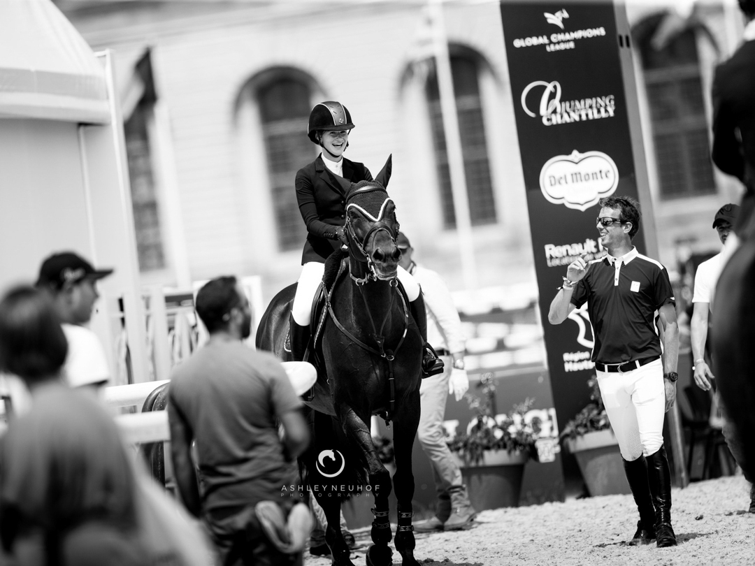 Jenn Gates and Dolinn with Harrie Smolders at the 2018 Global Champions Tour of Chantilly. Photo by Ashley Neuhof Photography.