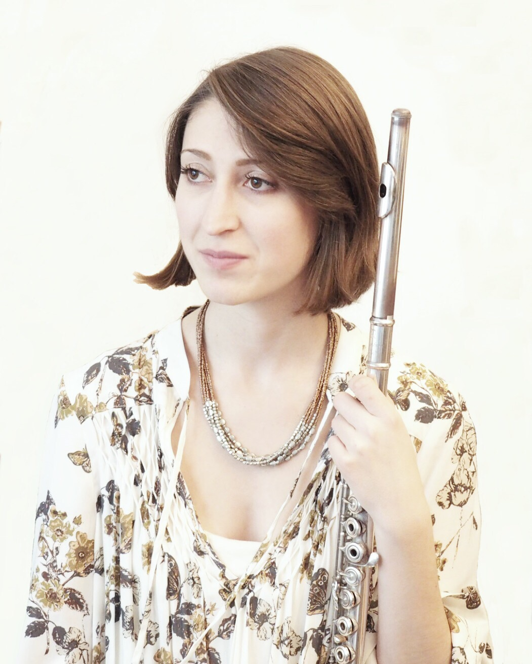 """Francesca Ferrara   Flutist Francesca Ferrara has followed her music from Santa Monica, California, where she grew up, to New York City. With the goal of building community, she dedicates her life to performing and advocating for new music. She frequently collaborates with composers and is a member of the New York City based ensemble, Amalgama. She has performed at the Contemporary Performance Institute under the direction of Fred Sherry, the Montreal Contemporary Music Lab, Cortona Sessions for New Music in Italy, and Fresh Inc Festival. Francesca is also the creator and director of  Common Senses , a """"concert"""" series that brings chefs and composers together to create multi-sensory experiences. She earned a Master of Music degree in Contemporary Performance from Manhattan School of Music where she was a student of Tara O'Connor, and a Bachelor of Music degree from The Boston Conservatory where she studied with Sarah Brady."""