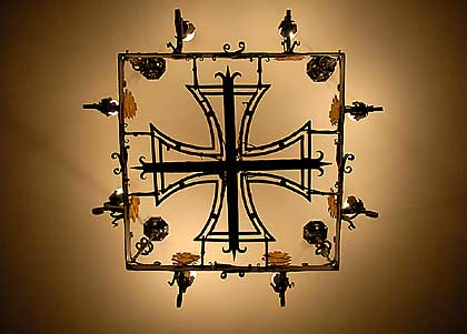 Inside the entrance hall of the church hangs a chandelier in the shape of an iron cross, complete with oak leaves (the symbol of courage in battle).