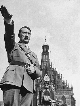 """Church & State   Hitler in front of """"Church of our Lady"""" in Nuremberg, Sept. 1934. Photographer, Heinrich Hoffmann.   (Source:  USHMM )"""