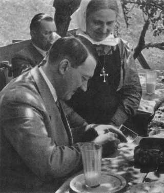 Hitler signing his autograph for a Christian fan   (Source: Hitler in Seinen Bergen, Heinrich Hoffmann, Berlin, den 24.9.35)