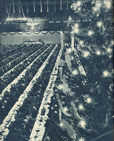 Autobahn workers as guests of Hitler in the Berlin  Sportpalast  at Christmas in 1938. Note the Christmas trees on the right. (Source:  calvin.edu )