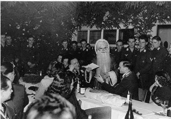 Christmas 1944 with Nazi officers and their girlfriends.  Note the German Santa Claus.  (Source:  www.dhm.de/ )