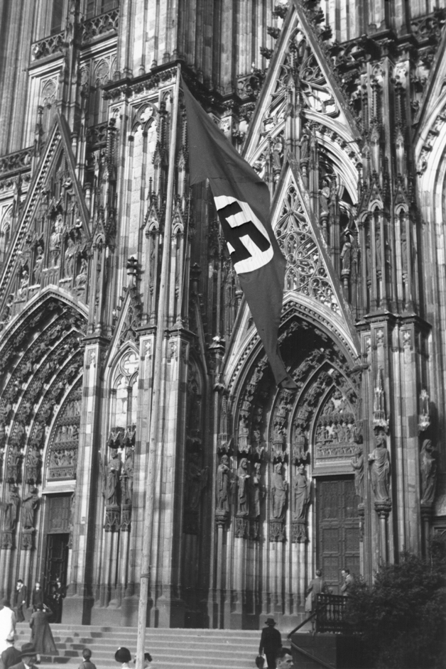 A Nazi flag flies in front of the Cologne Cathedral, 1937  (Source:  USHMM )