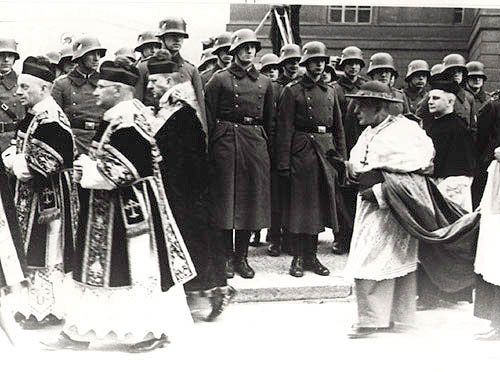 Cardinal Bertram in the funeral procession for Bishop Bares, Berlin, 7 March 1935    As a chairman of the German bishop conference the Breslauer Cardinal Bertram plays a crucial role in shaping the attitude of the German bishops in relation to the National Socialist state.  (Photo source:  Gedenkstätte Deutscher Widerstand )