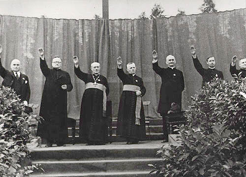 Priests giving the Hitler salute   Priests giving the Hitler salute at a Catholic youth rally in the Berlin-Neukölln stadium in August 1933.  (Source:  A Moral Reckoning: The Role of the Catholic Church in the Holocaust and Its Unfulfilled Duty of Repair  by Daniel Jonah Goldhagen)