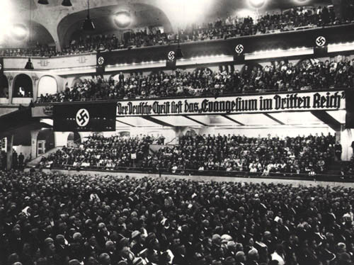 Mass meeting of the German Christian Movement   13 Nov.1933   A radical wing of German Lutheranism and the main Protestant branch supporting Nazi ideology, the German Christian Movement reconciled Christian doctrine with German nationalism and antisemitism.  (Source:  Museum of Tolerance )