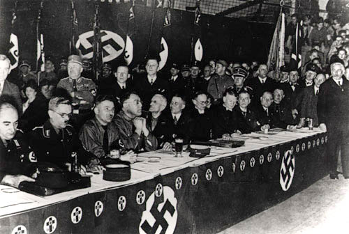 """Presidium of the """"German Christians,"""" Berlin, November 13, 1933   The """"German Christians"""" desired to achieve absolute organizational and ideological conformity between the Protestant church and the National Socialist state. Following their triumphant success in the Protestant church elections in July 1933 and the election of Ludwig Müller to the office of Reich bishop, they feel they have reached the zenith of their power over church policy in the autumn of 1933.  (Source:  Gedenkstätte Deutscher Widerstand )"""