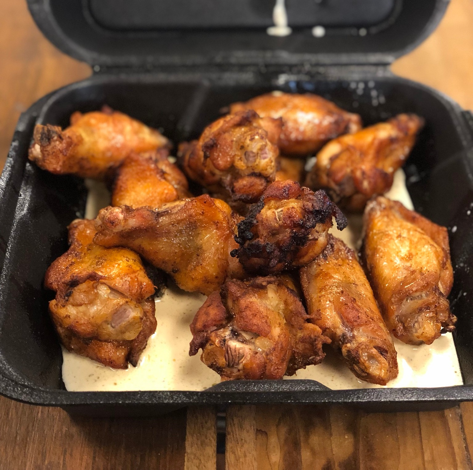 12 Smoked Signature Traditional Wings (No Glaze) with Alabama White Sauce. $15.25 (includes Tax)