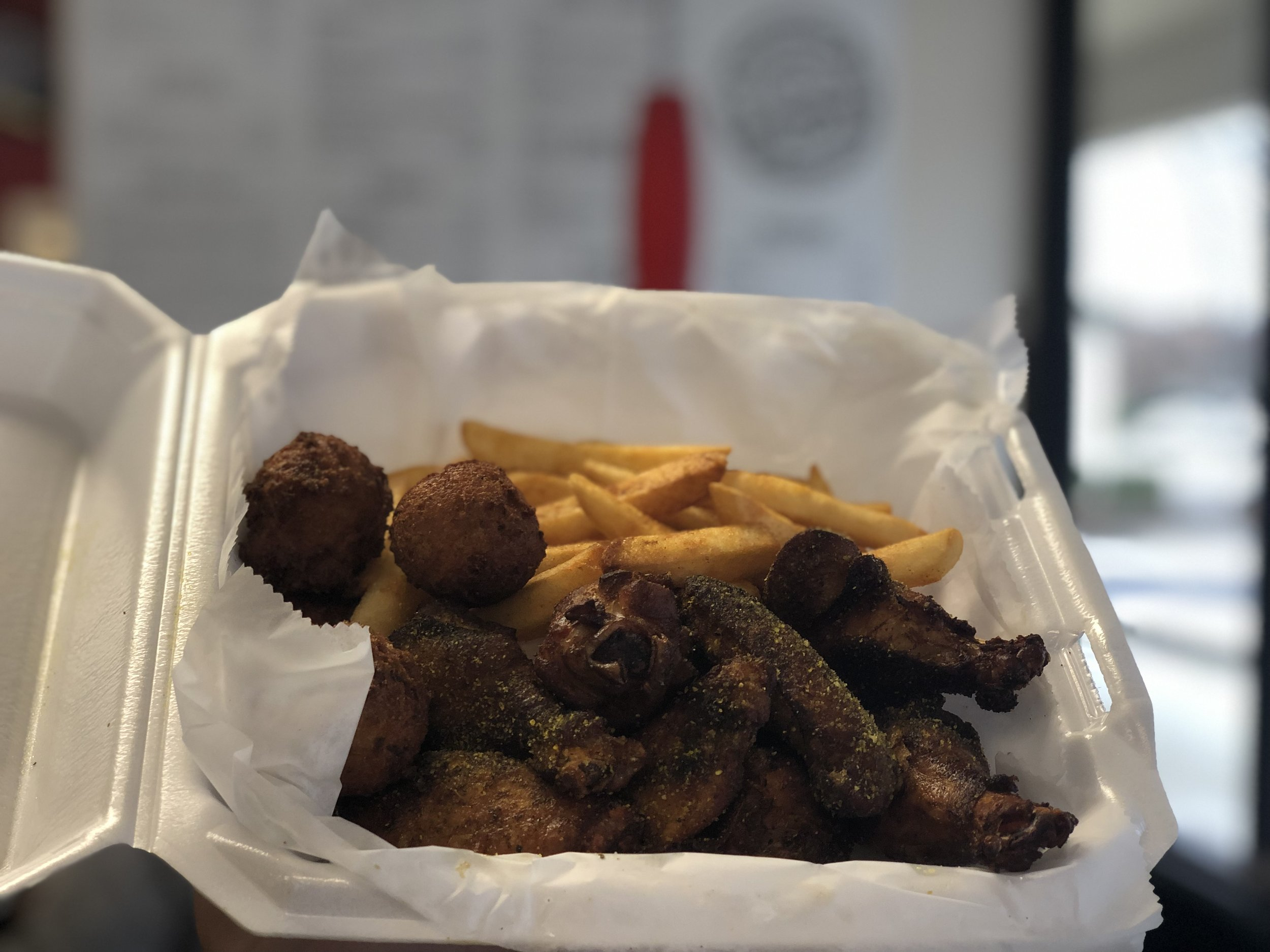 10 Smoked Traditional Wings with Lemon Pepper Dry Rub with Hushpuppies and Fries. $11.50 (Includes Tax)