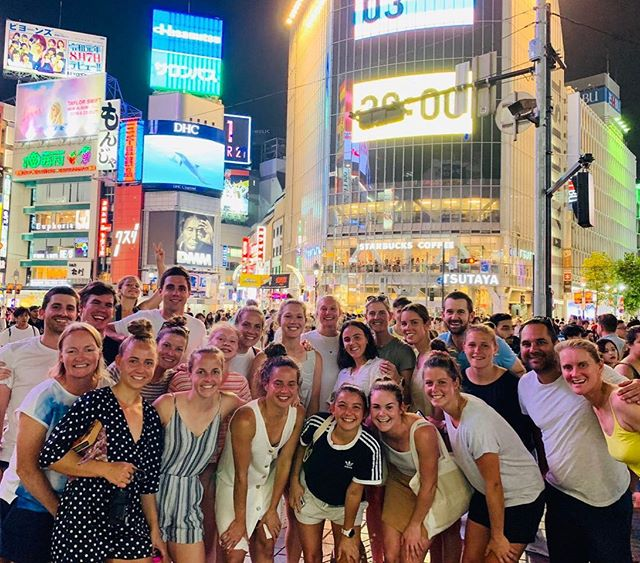 Several of our amazing camp coaches who are currently away representing the Australian Hockeyroos Team! 🏑✨  They visited one of the world's busiest street crossings after dining out at a traditional Japanese restaurant! Did someone say sushi?! 🍣