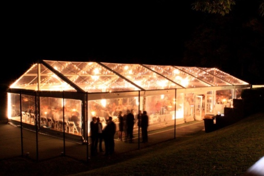 Clear Marquees with festoon lighting creates a stunning evening event space.