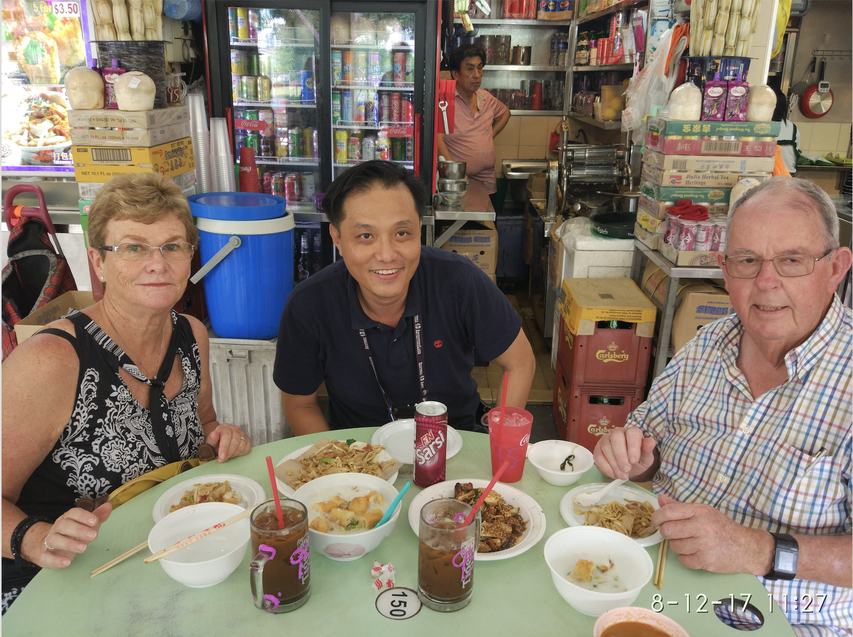John and Janelle on a Singapore Food Tour at Old Airport Road Hawker Centre