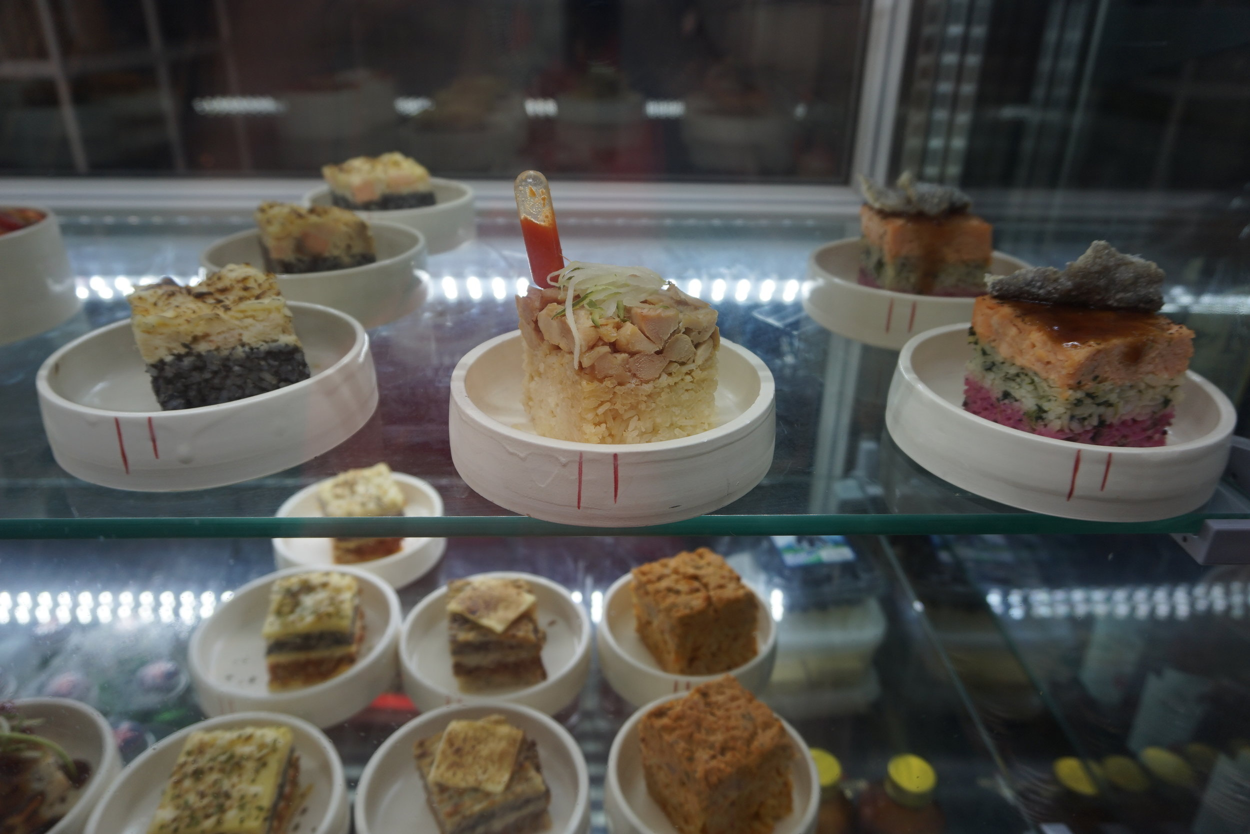 try a selection of local foods after your private tours in Singapore