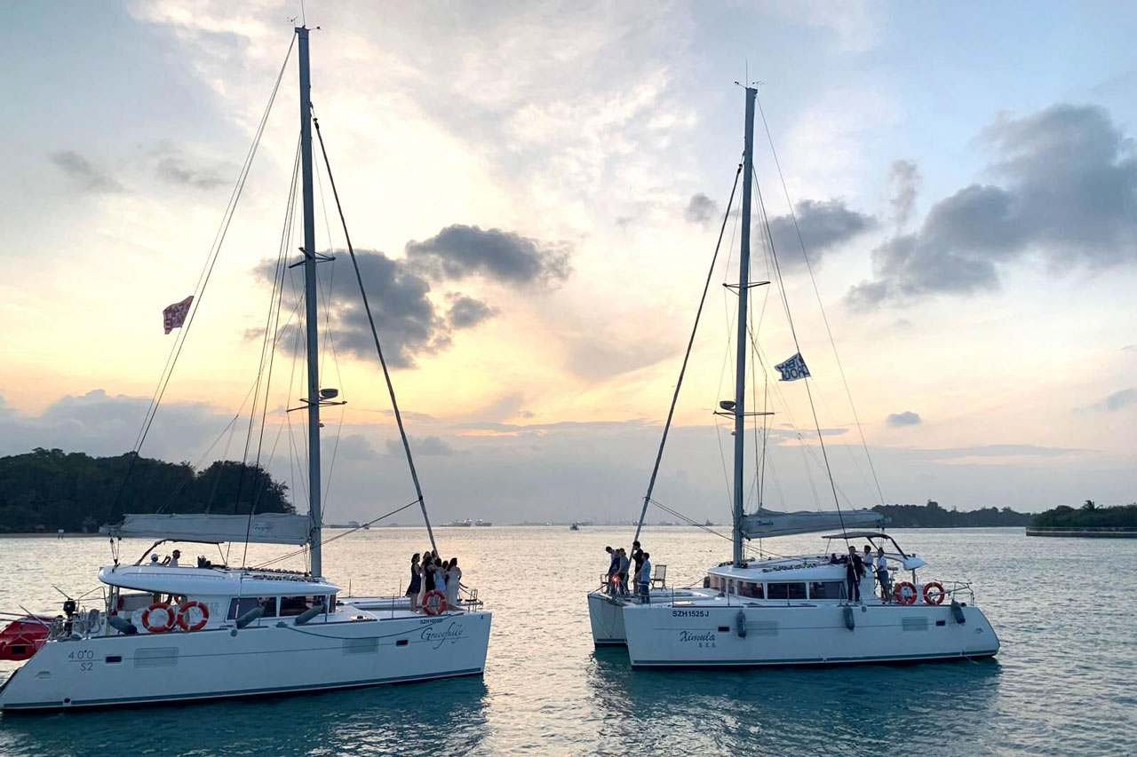 See the sunset while taking a Singapore harbour cruise