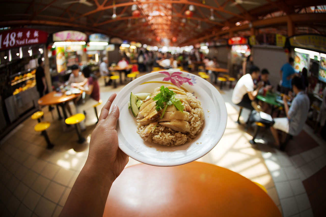 Eat chicken rice at Maxwell Hawker Centre on a Singapore night tour