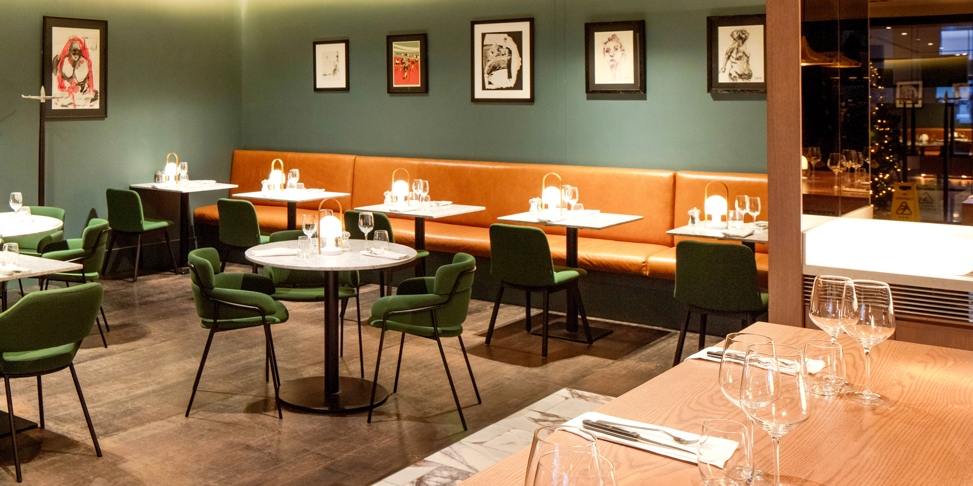 The Grahamston Kitchen I Restaurant seating area including booths and circular seating tables