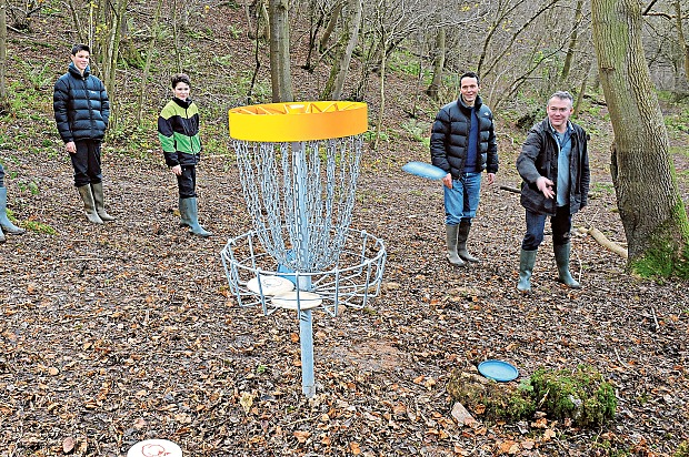 Spin doctors: Alex Wade and family play Frisbee Golf Photo: Jay Williams