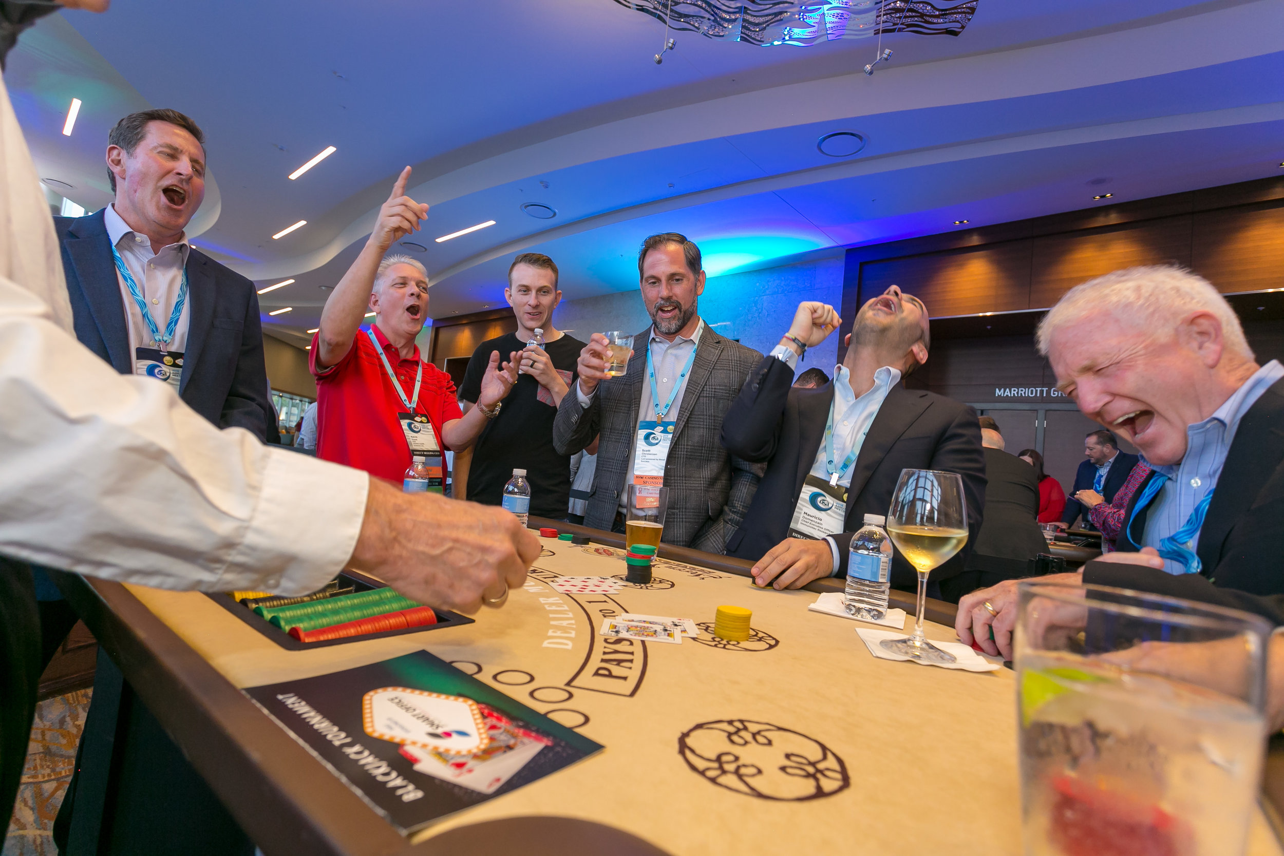 Group of men cheering at a casino table