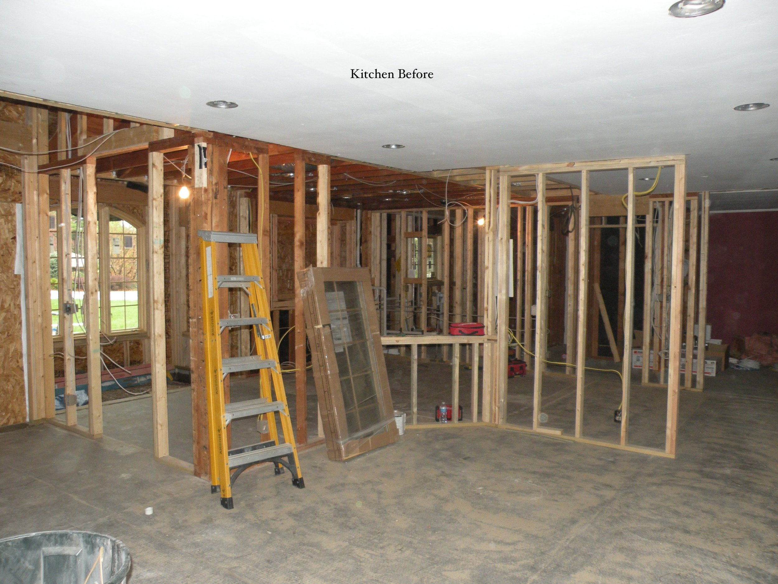 0004 Before Living Room Looking into Kitchen.JPG