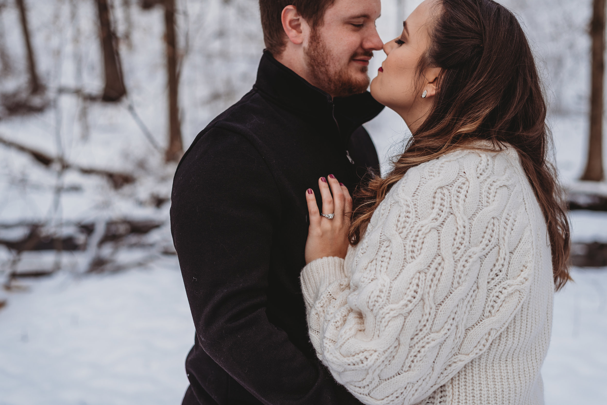engaged couple in snow