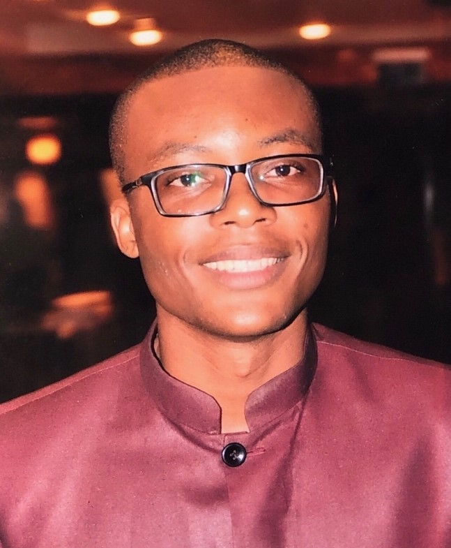 """Jean-Eric Bitang - University of Douala, Cameroon, October, 2019Jean Éric Bitang will hopefully receive his PhD from the University of Douala in 2020, where he has worked both as a teaching and research Assistant to Prof. Emboussi Nyano and Prof. Malolo Dissakè and as a temporary Lecturer in Philosophy, especially in Aesthetics and Philosophy of Art. His Dissertation focuses on the relationship between Modern and Contemporary Art in order to build a concept of Negative Modernity in the path of Theodor W. Adorno's aesthetic thought. One of his main interest is the Theory of Ugliness on which he has written a book to be published at Éditions Dianoïa, in Paris: À la recherche d'une théorie de la laideur. Petite Critique de la Raison esthétique [In Search of a Theory of Ugliness. A short Critique of Aesthetical Reason]. He has also published Journal articles and book chapters on Paulin Hountondji and African Philosophy (2016), inquiring about the revolutionary content of Art (2017), and dealing with Horkheimer and Adorno (2017). He is currently working on a book questioning the philosophical legacy of Marcien Towa (expected for late 2020-early 2021).As EthicsLab Fellow, Jean Éric Bitang will be working on the ethical issues arising from the return of African artworks to their native lands decided by Emmanuel Macron, President of France, in November 2018. To this extent, he will intensively discuss the """"Sarr/Savoy Report,"""" a document commissioned by the French Ministry of Culture and written together by Felwine Sarr and Bénédicte Savoy. This Report stands as the intellectual framework for this action of 'Returning back the African Cultural Heritage to Africa'. According to Sarr and Savoy, the aim of such an action is to move 'towards a new relational Ethics' with Africa in which the 'pacification of Memories' is certainly one of the main goals to achieve. Jean Éric Bitang's claim is that the notion of 'Responsibility' is the ethical concept at the core of this endeavor, """