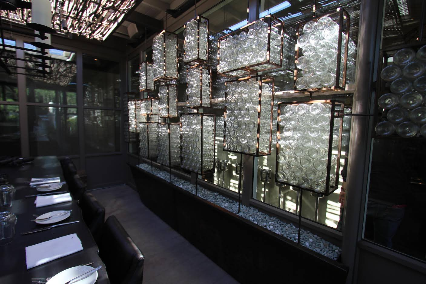 Custom glass and metal wall installation created for a restaurant/wine bar in Napa. We fabricated and assembled the glass components in this site specific piece.
