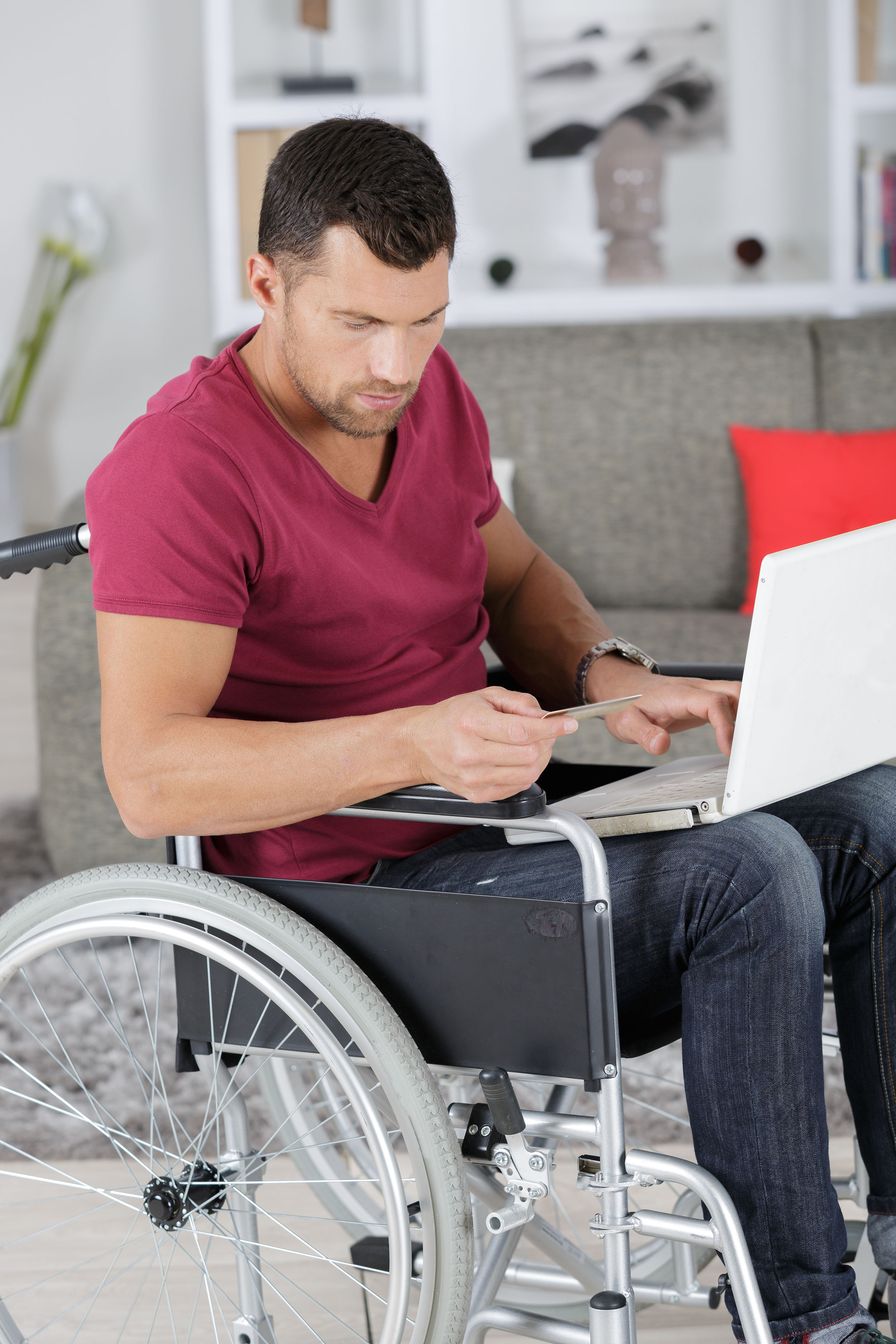 Disabled man in wheelchair typing on laptop.jpg