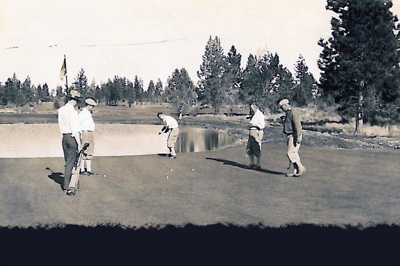 A foursome finishes putting on #11, which at the time of this photo was #7 on the original 9-hole course.