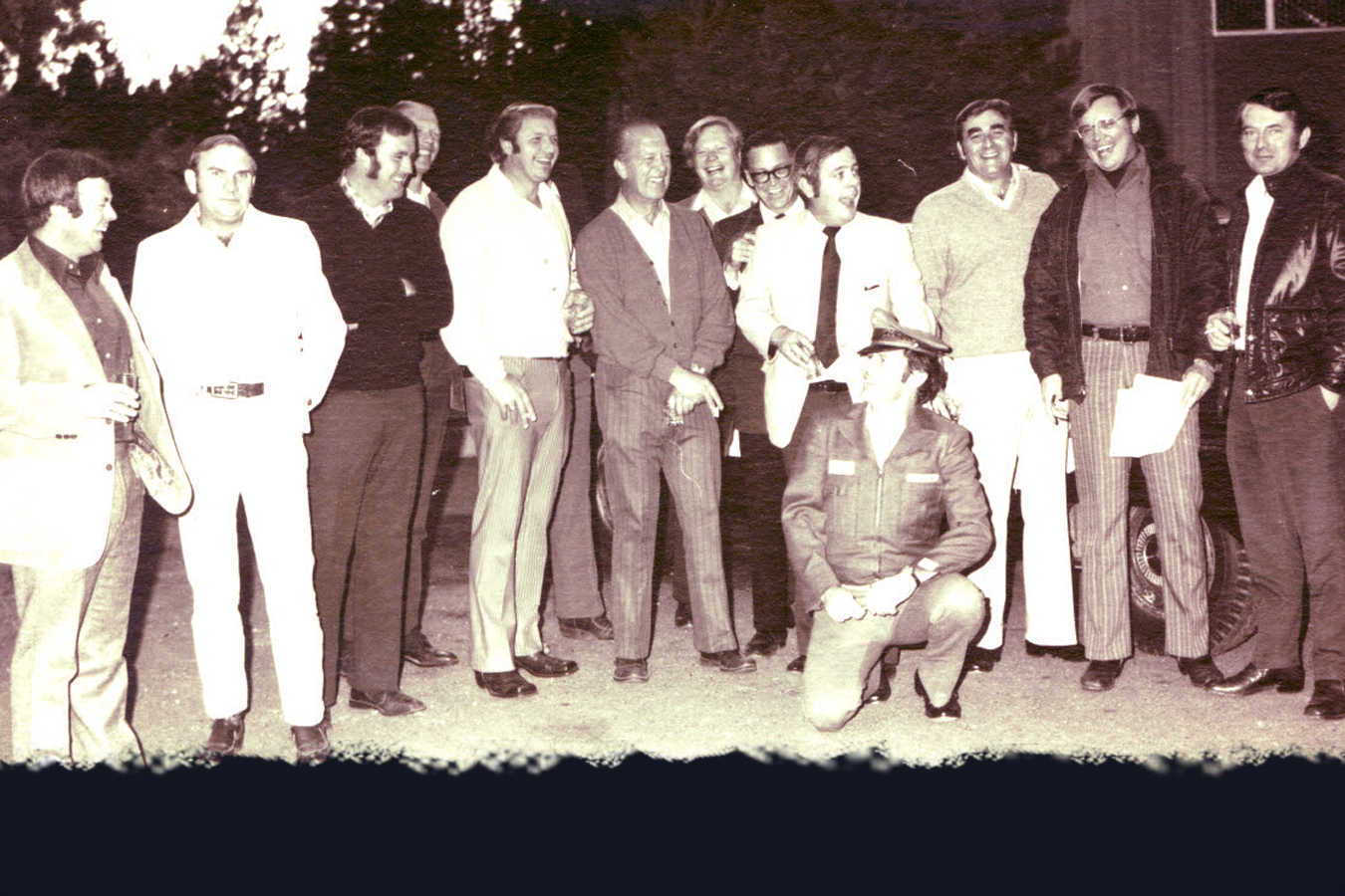 After taking over for a drunken cab driver on a group visit to Las Vegas in 1980, member Curt Boulet (kneeling) receives a Checker taxi, jacket and hat as a joke from fellow Club members on his birthday.