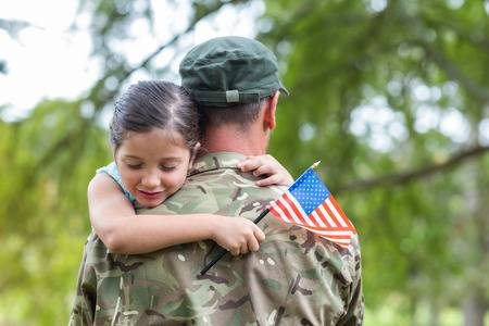 42671839-soldier-reunited-with-his-daughter-on-a-sunny-day.jpg